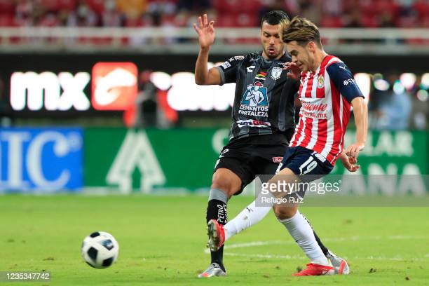 Jesús Angulo of Chivas fights for the ball with Gustavo Cabral of Pachuca during the 9th round match between Chivas and Pachuca as part of the Torneo...