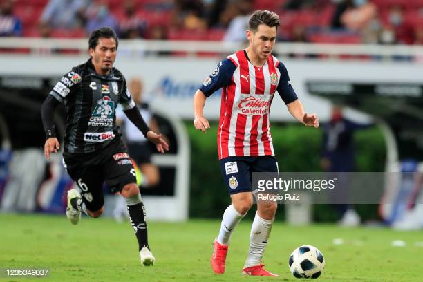 Jesús Angulo of Chivas fights for the ball with Jorge Hernández of Pachuca during the 9th round match between Chivas and Pachuca as part of the...