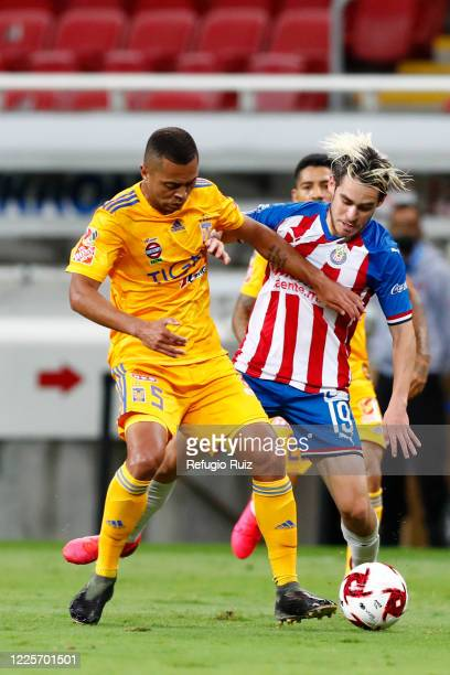 Jesús Angulo of Chivas fights for the ball with Rafael de Souza of Tigres during the match between Chivas and Tigres UANL as part of the friendly...