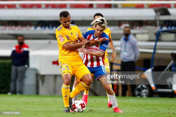 Jesús Angulo of Chivas jumps for the ball with Rafael de Souza of Tigres during the match between Chivas and Tigres UANL as part of the friendly...