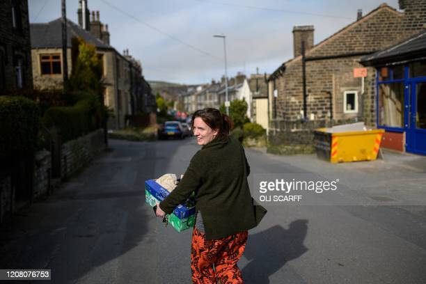 Jess Atkinson a volunteer for the community owned grocery shop The Village Green delivers an emailed order from a local resident selfisolating amidst...