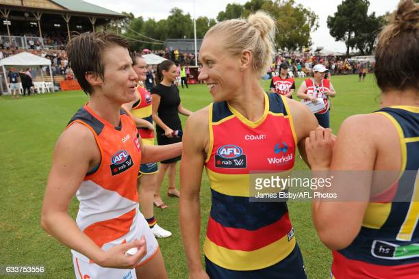 Jess Bibby of the Giants congratulates Erin Phillips of the Crows during the 2017 AFLW Round 01 match between the Adelaide Crows and the GWS Giants...