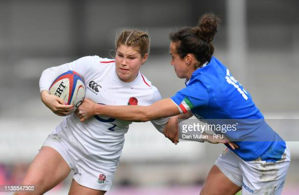 Jess Breach of England is tackled by Manuela Furlan of Italy during the Womens Six Nations match between England and Italy at Sandy Park on March 09...