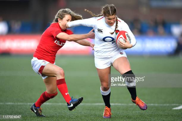 Jess Breach of England makes a break past Elinor Snowsill of Wales during the Wales Women and England Women match in the Women's Six Nations at...