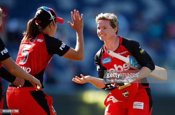 Jess Cameron celebrates hitting the winning runs on the final ball in a super over during the Women's Big Bash League match between the Melbourne...