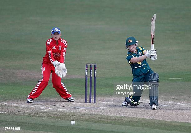 Jess Cameron of Australia hits out watched by England wicketkeeper Sarah Taylor during the third NatWest One Day International match between England...