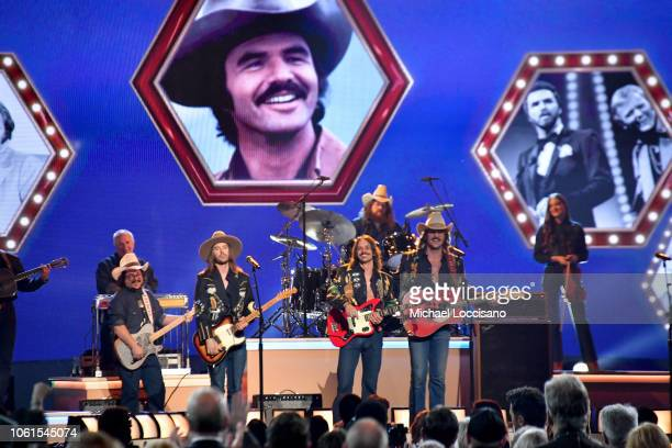 Jess Carson Cameron Duddy and Mark Wystrach of Midland perform onstage during the 52nd annual CMA Awards at the Bridgestone Arena on November 14 2018...