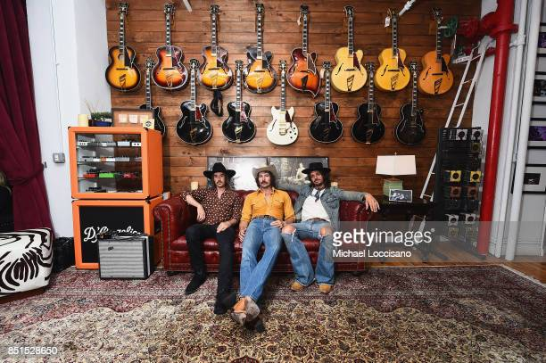 Jess Carson Mark Wystrach and Cameron Duddy of MIDLAND at D'Angelico Guitar Showroom on September 21 2017 in New York City