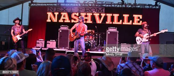 Jess Carson Mark Wystrach and Cameron Duddy of Midland perform during the Route 91 Harvest country music festival at the Las Vegas Village on...