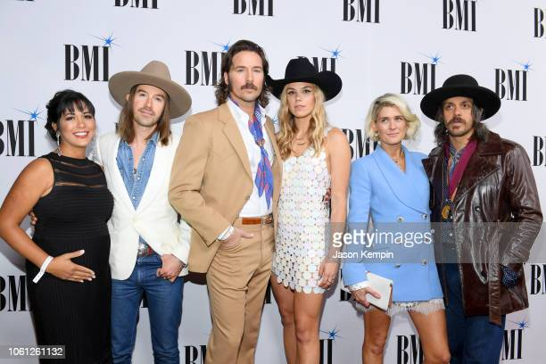 Jess Carson Mark Wystrach and Cameron Duddy of Midland pose with Camille Carson Tyler Haney and Harper Smith attend the 66th Annual BMI Country...