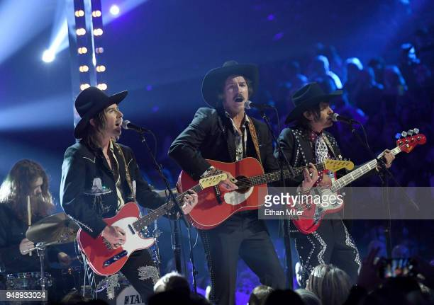 Jess Carson Mark Wystrach and Cameron Duddy of musical group Midland perform during the 53rd Academy of Country Music Awards at MGM Grand Garden...