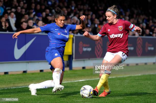 Jess Carter of Chelsea battles for possession with Leanne Kiernan of West Ham United during the FA Women's Super League match between Chelsea Women...