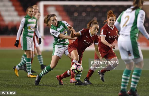 Jess Clarke of Liverpool Ladies competes with Georgia Evans of Yeovil Town Ladies during the FA Women's Super League match between Liverpool Ladies...