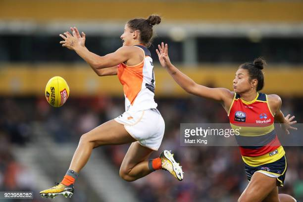 Jess Dal Pos of the Giants handles the ball during the round four AFLW match between the Greater Western Sydney Giants and the Adelaide Crows at...