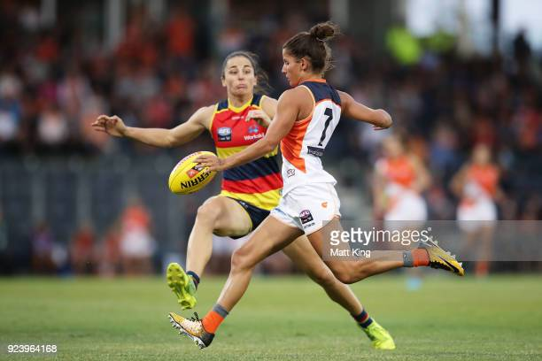 Jess Dal Pos of the Giants kicks under pressure during the round four AFLW match between the Greater Western Sydney Giants and the Adelaide Crows at...