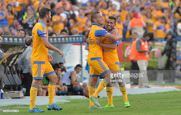 Jesús Dueñas of Tigres celebrates with his teammates after scoring the first goal of his team during a 7th round match between Tigres UANL and...