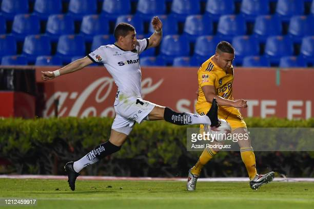 Jesús Dueñas of Tigres fights for the ball with Mauro Fernández of Juárez during the 10th round match between Tigres UANL and FC Juarez as part of...
