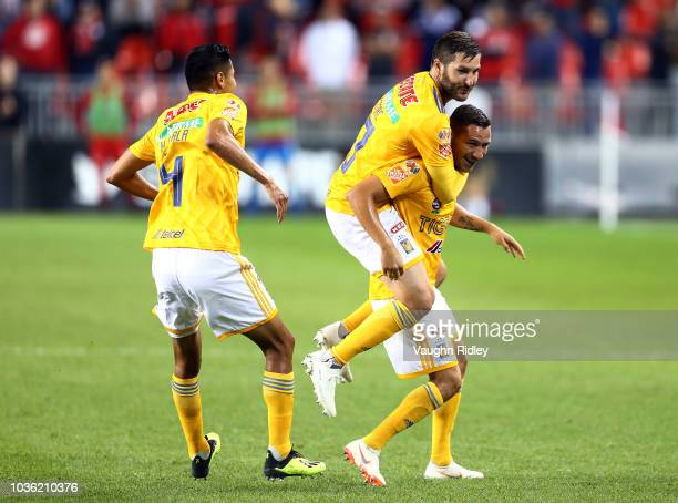 Jesús Dueñas of Tigres UANL celebrates a goal with AndréPierre Gignac during the second half of the 2018 Campeones Cup Final against Toronto FC at...