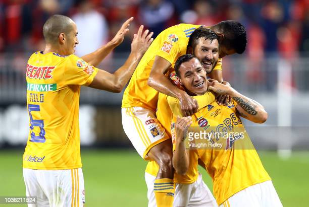 Jesús Dueñas of Tigres UANL celebrates a goal with teammates during the second half of the 2018 Campeones Cup Final against Toronto FC at BMO Field...