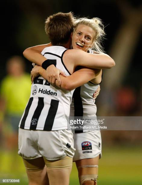 Jess Duffin of the Magpies celebrates on the final siren with Christina Bernardi of the Magpies during the 2018 AFLW Round 04 match between the...