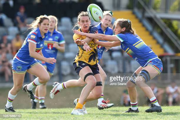Jess Elliston of Bond University passes the ball during the Aon Uni 7s match between Macquarie University and Bond University on September 22 2018 in...