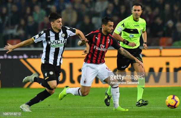 Jesús Fernández Suso of AC Milan competes for the ball with Ignacio Pussetto of Udinese Calcio during the Serie A match between Udinese and AC Milan...
