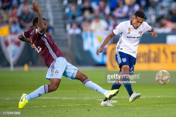 Jesús Ferreira of FC Dallas dribbles past Kellyn Acosta of the Colorado Rapids during the first half at Dick's Sporting Goods Park on September 29...