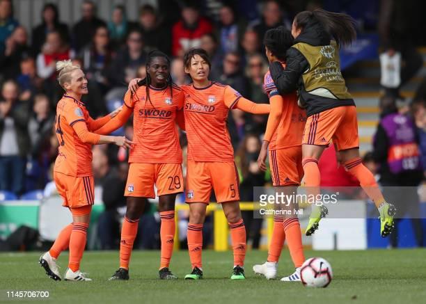 Jess Fishlock Griege Mbock Bathy and Saki Kumagai of Olympique Lyonnais celebrate with their team mates after the Women UEFA Champions League semi...