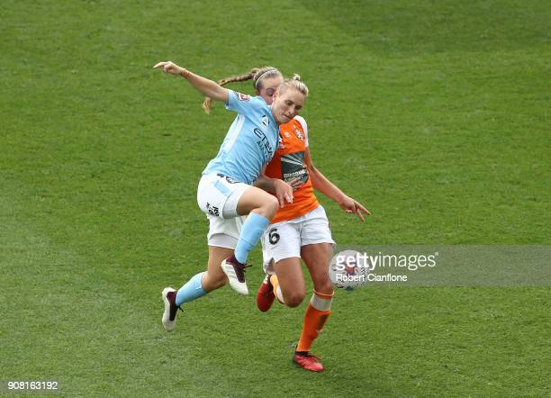 Jess Fishlock of Melbourne City gets the ball ahead of Celeste Boureille of the Roar during the round 12 WLeague match between Melbourne City and the...