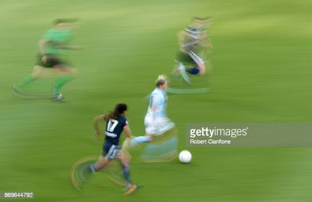 Jess Fishlock of Melbourne City runs with the ball during the round two WLeague match between Melbourne City FC and Melbourne Victory at AAMI Park on...