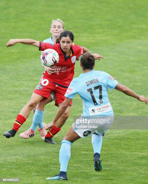 Jess Fishlock of the City and Alex Chidiac of United compete for the ball during the round six WLeague match between Melbourne City and Adelaide...