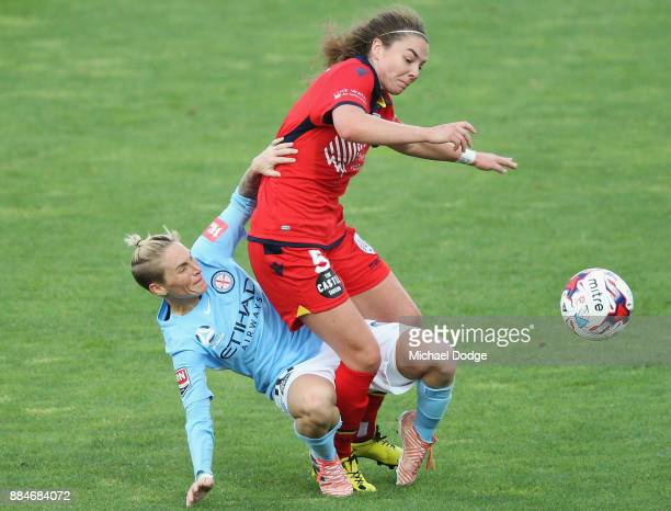 Jess Fishlock of the City and Jenna McCormick of United compete for the ball during the round six WLeague match between Melbourne City and Adelaide...