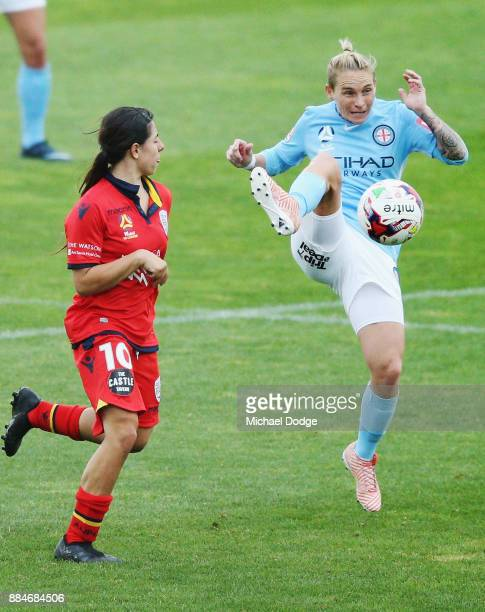 Jess Fishlock of the City controls the ball from Alex Chidiac of United during the round six WLeague match between Melbourne City and Adelaide United...
