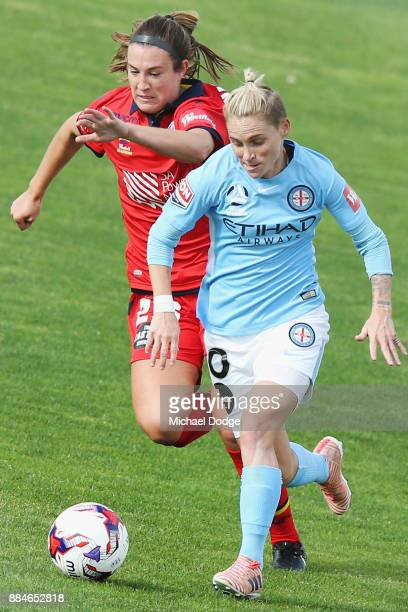 Jess Fishlock of the City runs with the ball from Emily Hodgson of United during the round six WLeague match between Melbourne City and Adelaide...