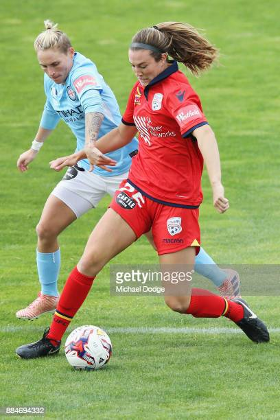 Jess Fishlock of the City tries to hold back Katie Naughton of United during the round six WLeague match between Melbourne City and Adelaide United...