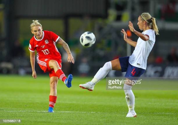 Jess Fishlock of Wales Women shoots at goal while under pressure from Jordan Nobbs of England Women during 2019 FIFA Women's World Cup Group 1...