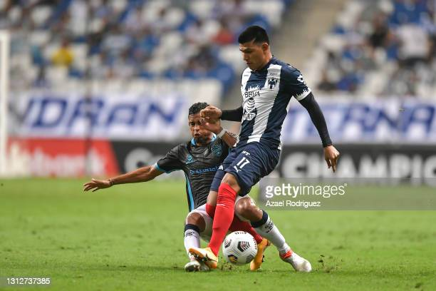 Jesús Gallardo of Monterrey fights for the ball with Leonardo Ossa of Atlético Pantoja during a second leg match between Monterrey and Atletico...