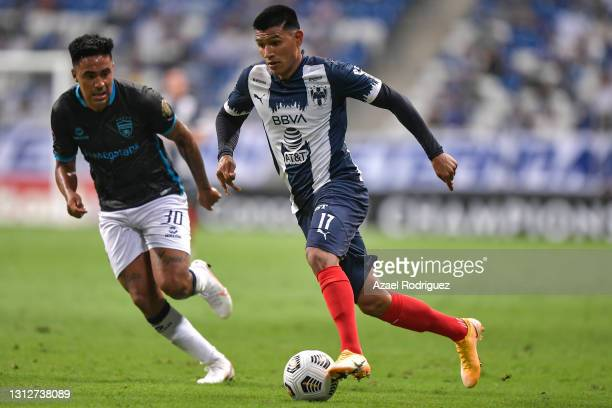 Jesús Gallardo of Monterrey fights for the ball with Santiago Paz of Atlético Pantoja during a second leg match between Monterrey and Atletico...