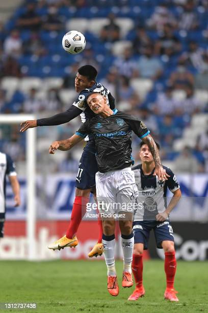 Jesús Gallardo of Monterrey heads the ball with Lisandro Cabrera of Atlético Pantoja during a second leg match between Monterrey and Atletico Pantoja...