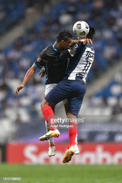 Jesús Gallardo of Monterrey heads the ball with Santiago Paz of Atlético Pantoja during a second leg match between Monterrey and Atletico Pantoja as...