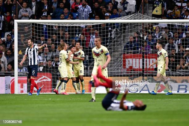 Jesús Gallardo of Monterrey lies on the ground while players of América celebrate an own goal by José María Basanta of Monterrey that was later...