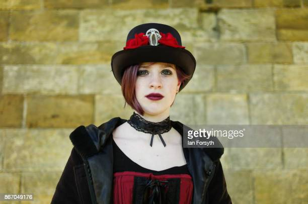 Jess Hutson-Pope from Surrey poses for the camera in Whitby Abbey during the Whitby Goth Weekend on October 27, 2017 in Whitby, England. The Whitby...
