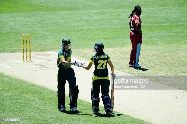 Jess Jonassen acknowledes Meg Lanning of Australia for hitting a boundary during the women's International Twenty20 match between Australia and the...