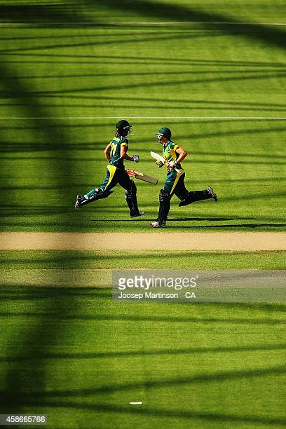 Jess Jonassen and Elyse Villani of Australia run a single during game four of the women's International Twenty20 series between Australia and the...
