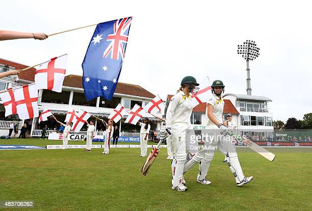 Jess Jonassen and Kristen Beams of Australia make their way onto the field for the start of play during day two of the Kia Women's Test of the...