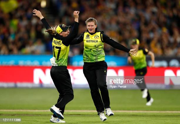 Jess Jonassen and Meg Lanning of Australia celebrate after taking the wicket of Harmanpreet Kaur of India during the ICC Women's T20 Cricket World...