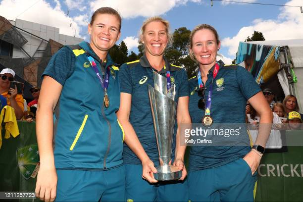 Jess Jonassen Delissa Kimmince and Beth Mooney of the Australian Women's T20 World Cup team celebrate with the trophy after winning the ICC Women's...