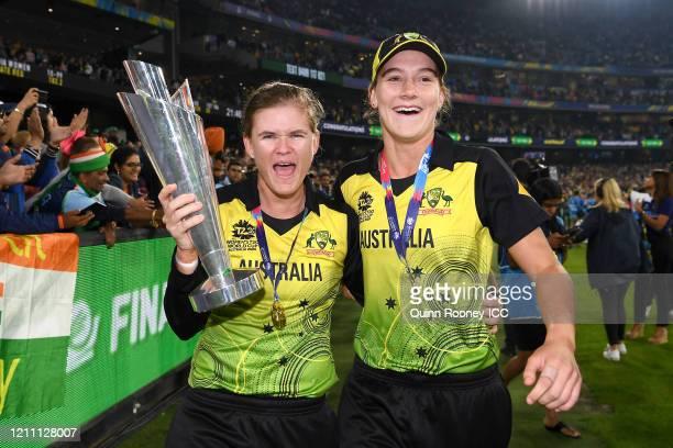 Jess Jonassen of Australia and Annabel Sutherland of Australia celebrate after winning during the ICC Women's T20 Cricket World Cup Final match...