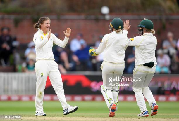 Jess Jonassen of Australia celebrate the wicket of Nat Sciver of England with Beth Mooney and Alyssa Healy of Australia during Day Four of the Kia...