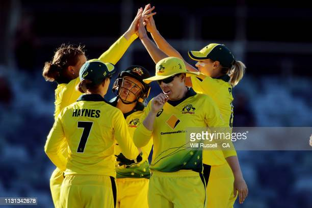 Jess Jonassen of Australia celebrates after taking the wicket of Amy Satterthwaite of New Zealand during Game 1 of the Women's One Day International...